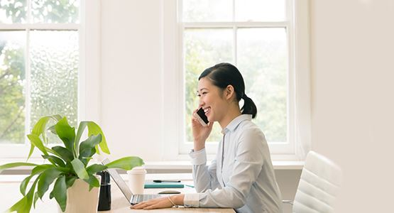 TBA_young_business_woman_office_phone_805x380.jpg
