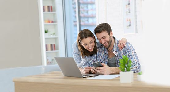 TBA_young_couple_home_laptop_805x380.jpg